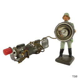 Lineol Signals soldier standing, with searchlight