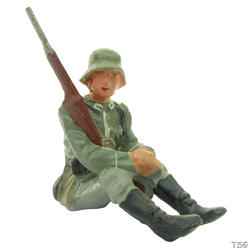 Lineol Infantry soldier sitting, with rifle