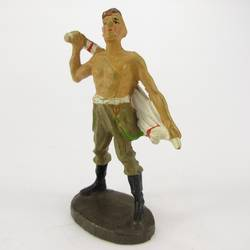 Infantry soldier standing, drying himself