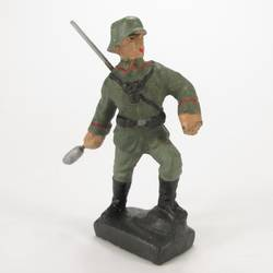 Infantry soldier standing, throwing hand grenade